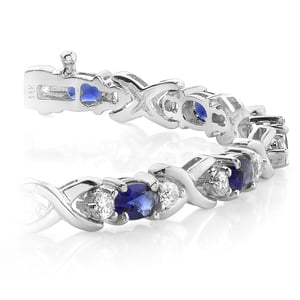 Twisted Diamond & Blue Sapphire Oval Gem Bracelet in White Gold (9 ctw)