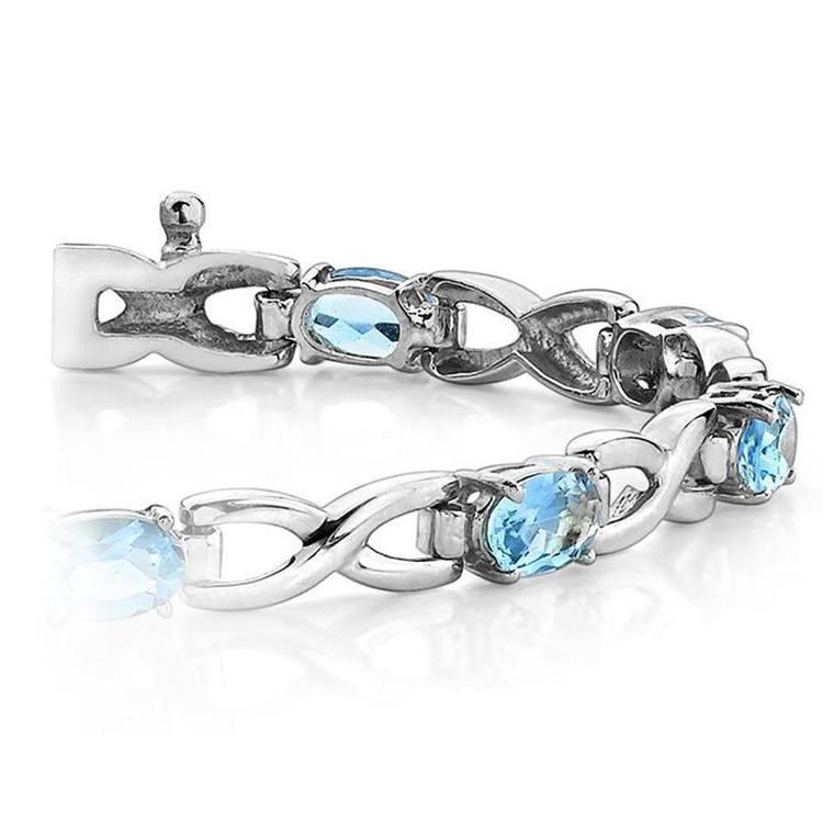 Twisted Swiss Blue Topaz Oval-Cut Gem Bracelet In White Gold (5 Ctw) | 01