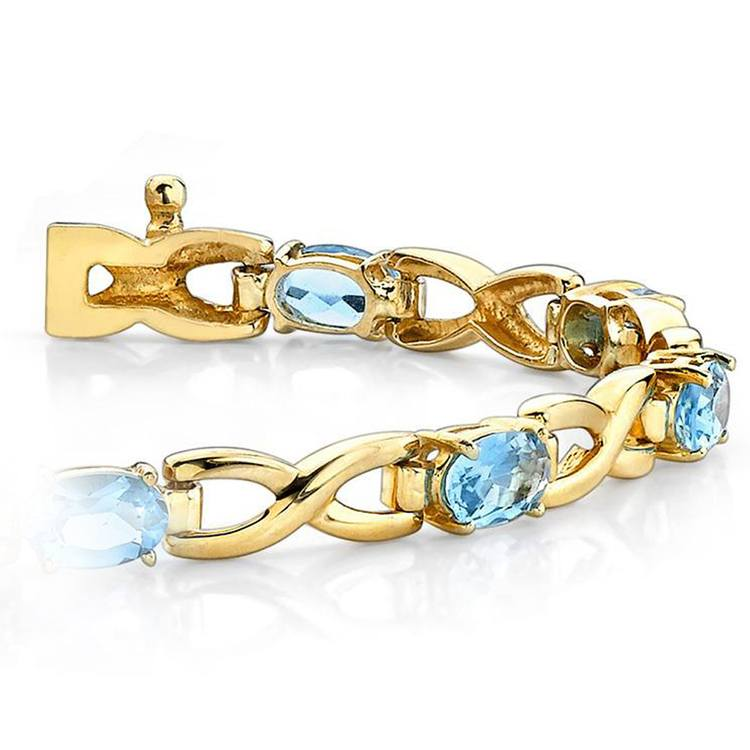 Twisted Swiss Blue Topaz Oval-Cut Gem Bracelet in Yellow Gold (5 ctw) | 01