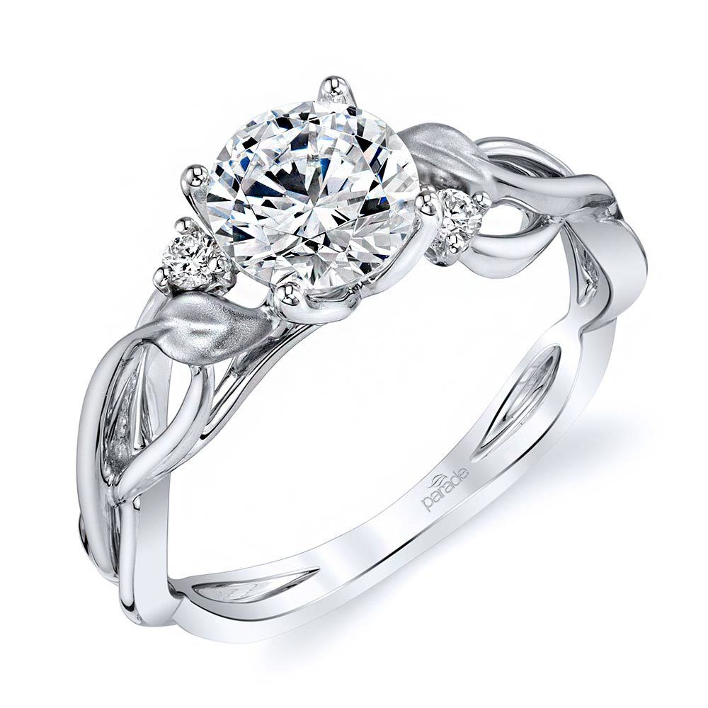 It is a picture of Intricate Leaves Three Stone Diamond Engagement Ring In White Gold By Parade