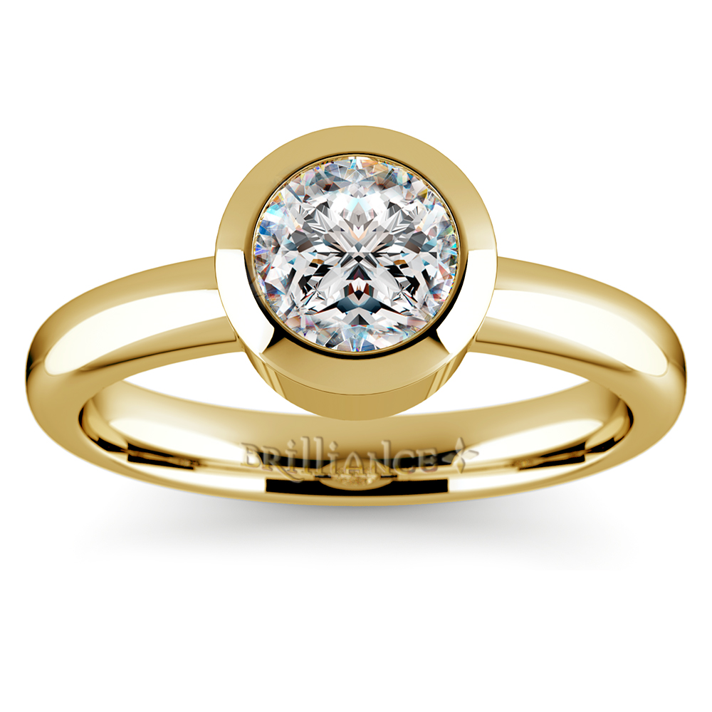bezel solitaire engagement ring in yellow gold