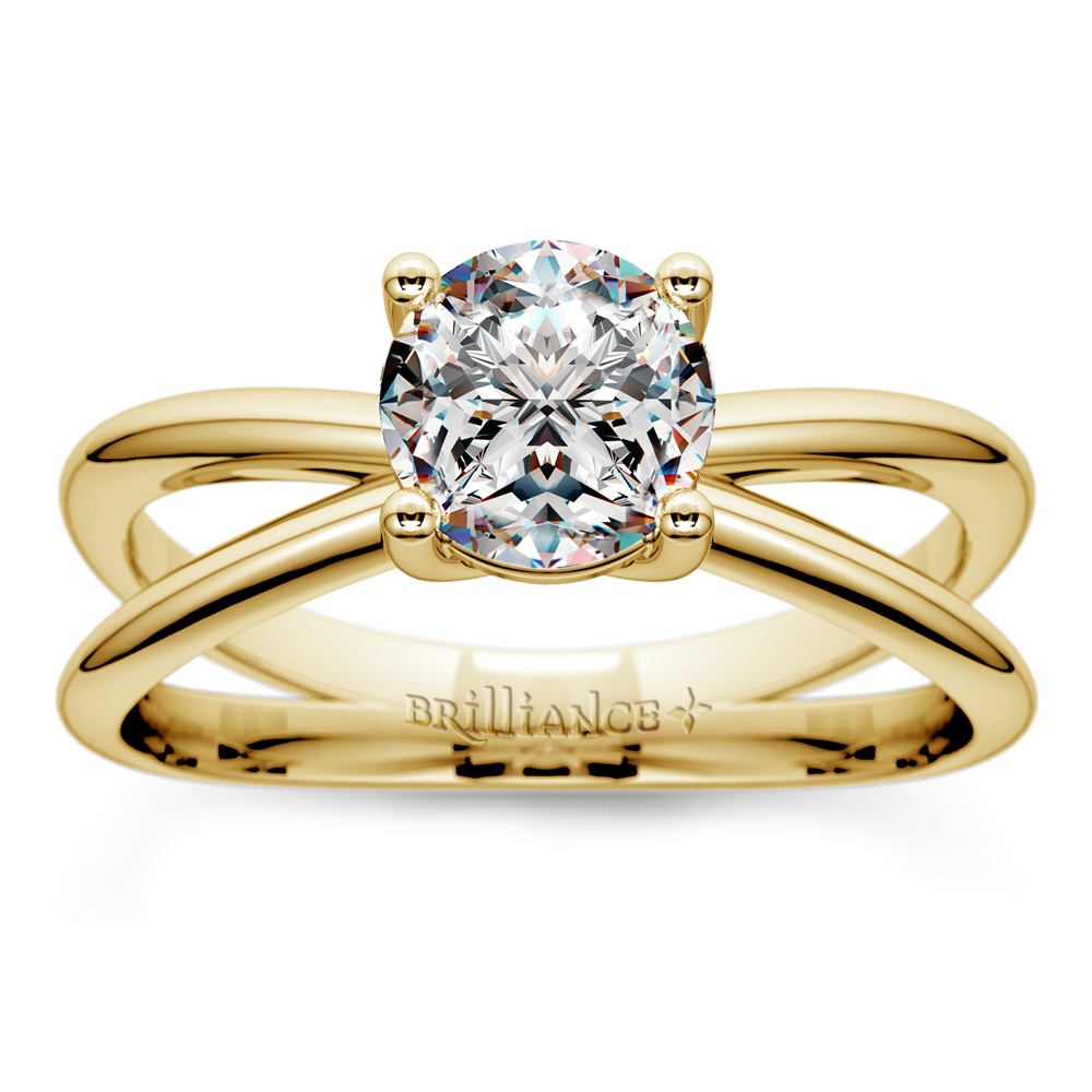 cross split shank solitaire engagement ring in yellow gold