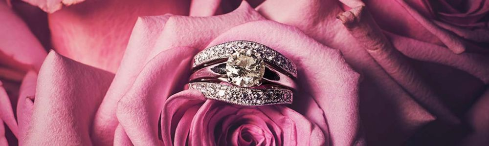 round cut diamond ring in pink roses