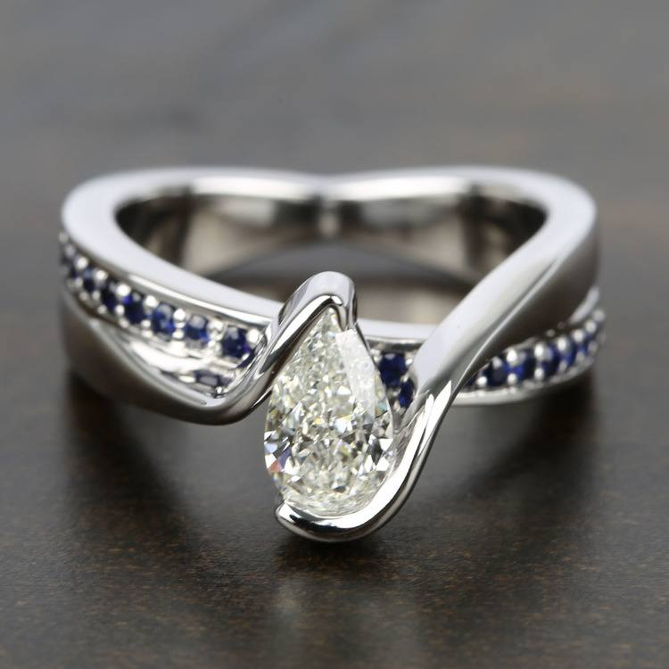 Bezel Bridge Sapphire Engagement Ring with Pear Diamond