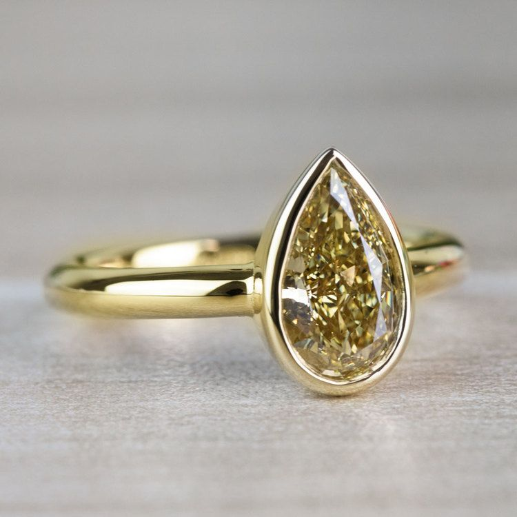 1.25 Carat Fancy Yellow Pear Diamond Bezel Solitaire Engagement Ring angle 3