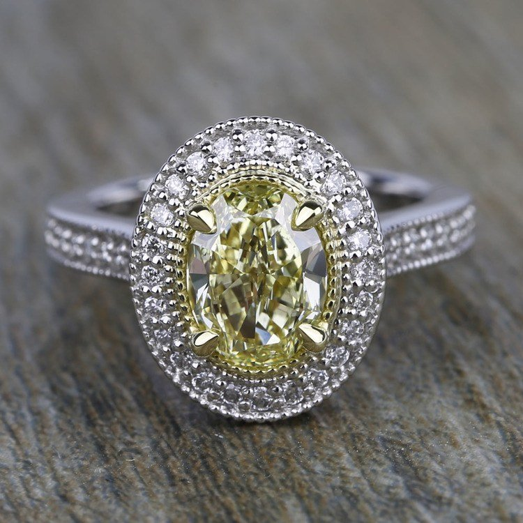 Antique Halo Engagement Ring with Oval Yellow Diamond