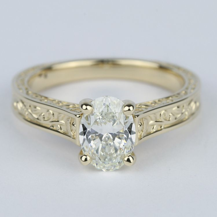 Antique Hand-Engraved Engagement Ring with Oval Diamond
