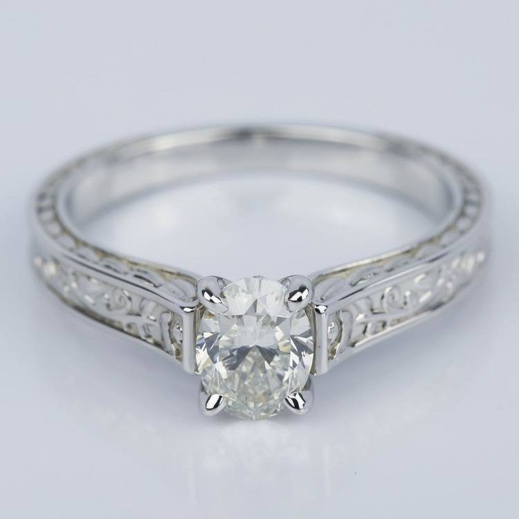 Antique Floral 0.90 Carat Oval Diamond Engagement Ring