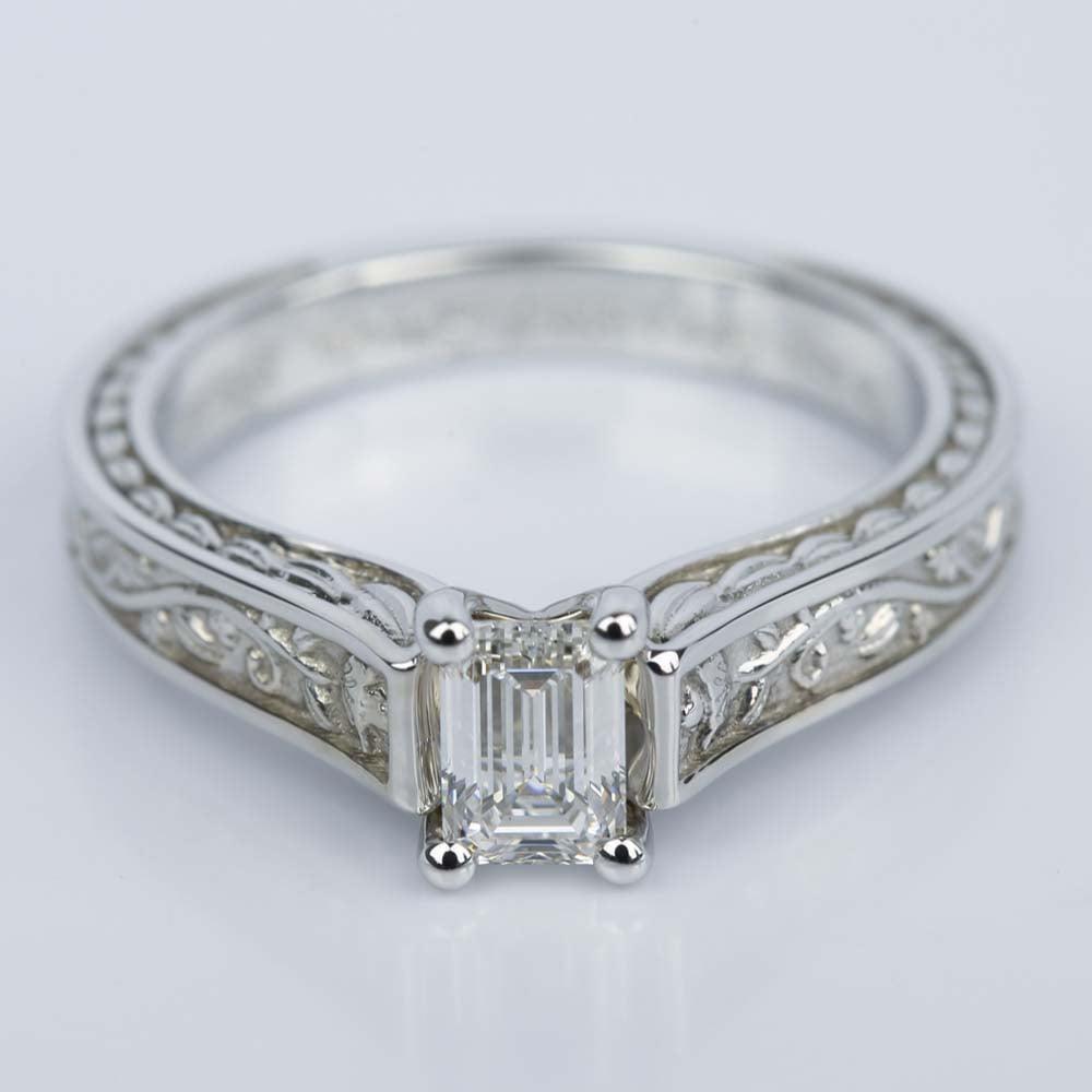 antique floral solitaire emerald engagement ring