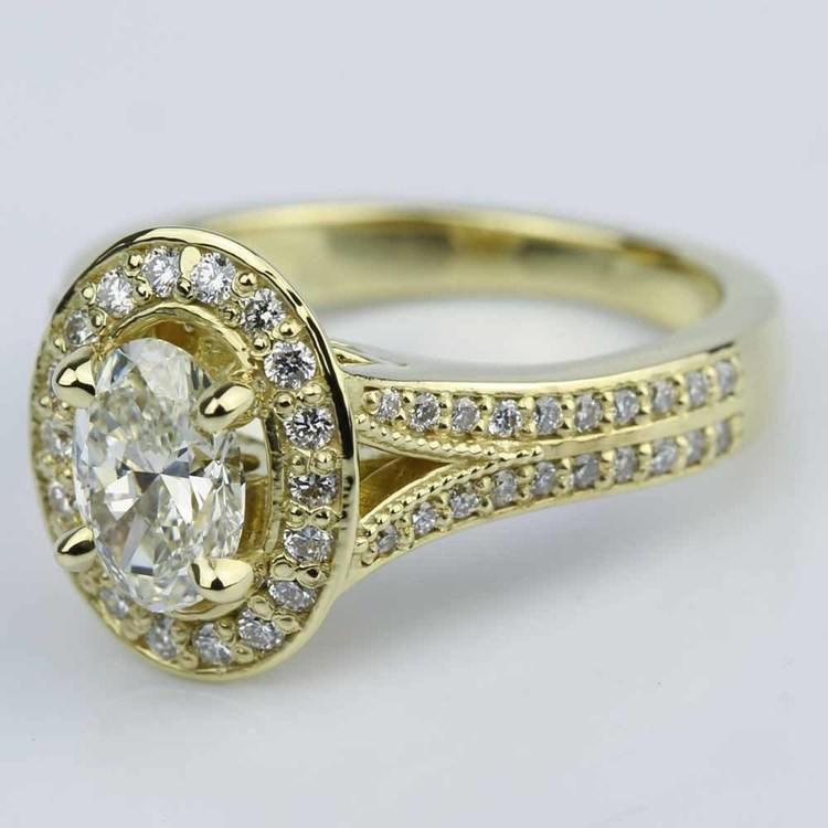 Antique Oval Diamond Engagement Ring in Yellow Gold angle 2