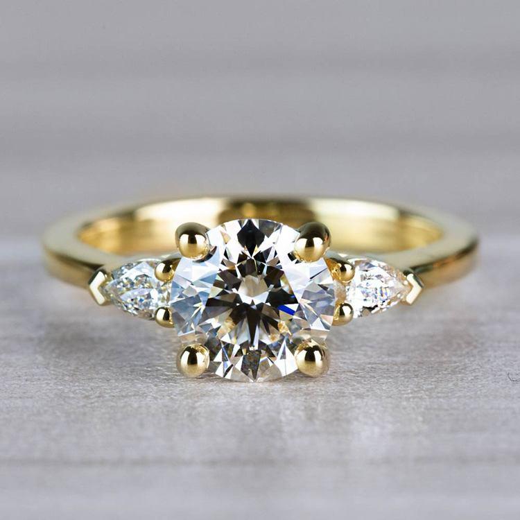 Brilliant 1.33 Carat Round Diamond With Pear Side Stones