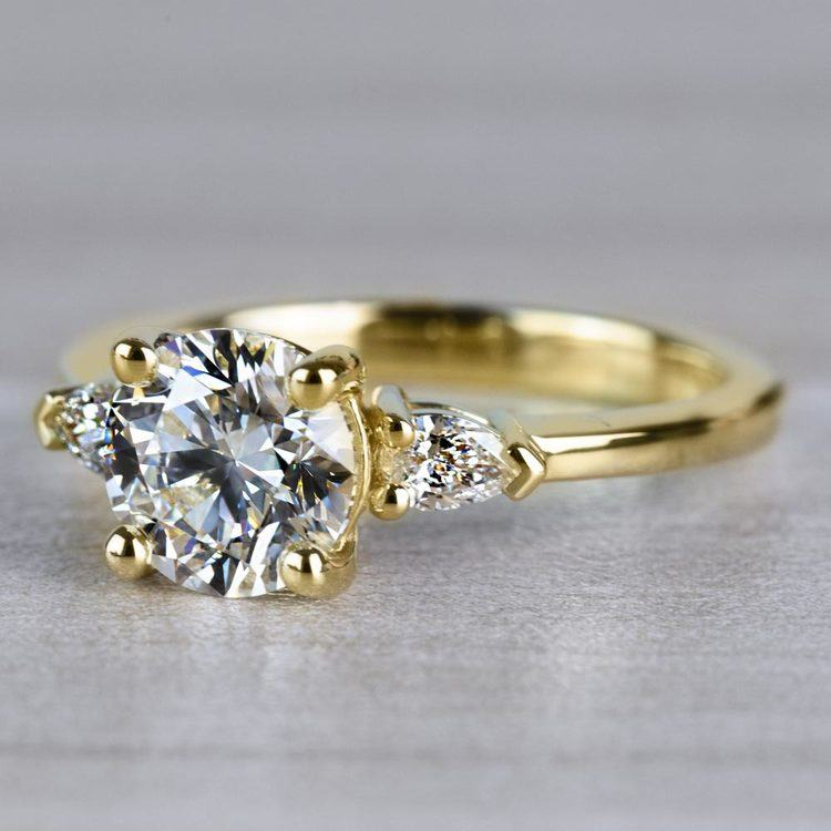 Brilliant 1.33 Carat Round Diamond With Pear Side Stones angle 2