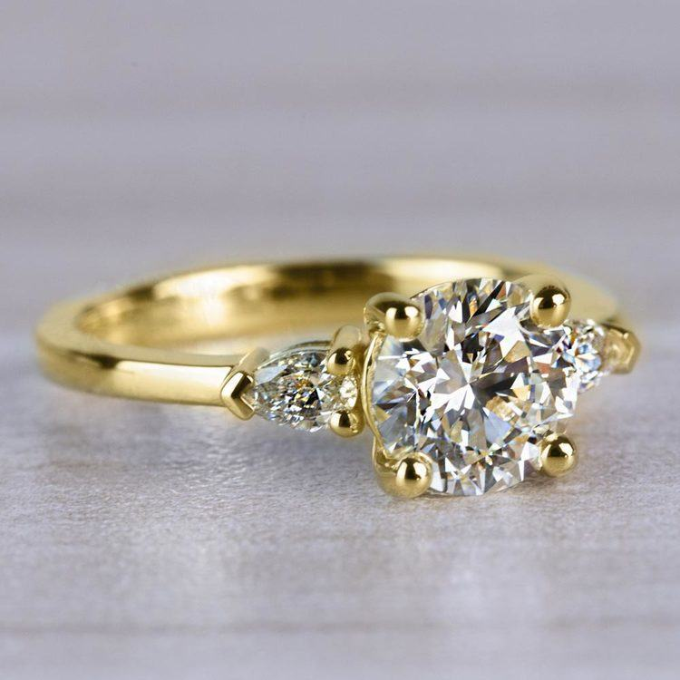 Brilliant 1.33 Carat Round Diamond With Pear Side Stones angle 3