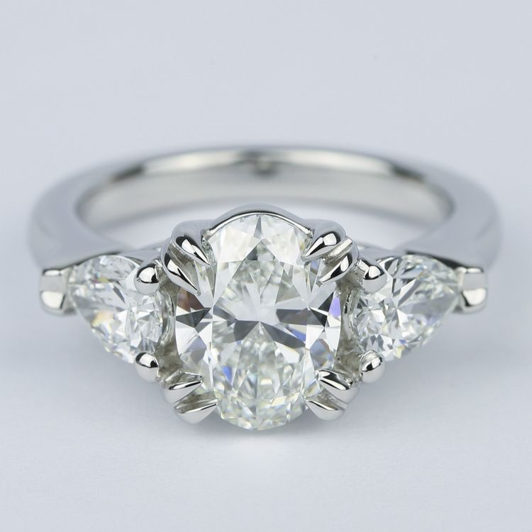 Oval Diamond Engagement Ring with Pear Diamonds in Platinum