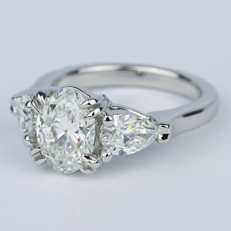Oval Diamond Engagement Ring with Pear Diamonds in Platinum angle 2