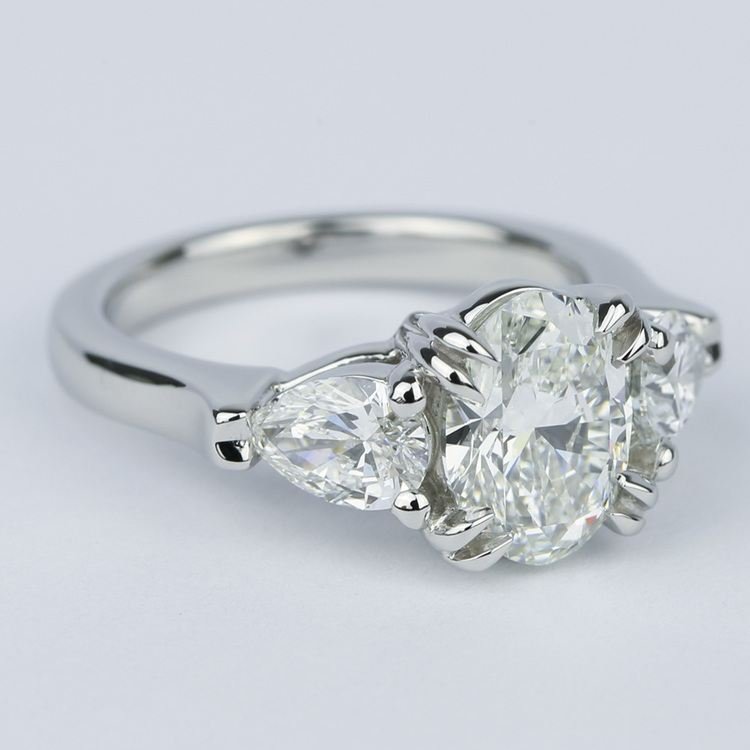 Oval Diamond Engagement Ring with Pear Diamonds in Platinum angle 3