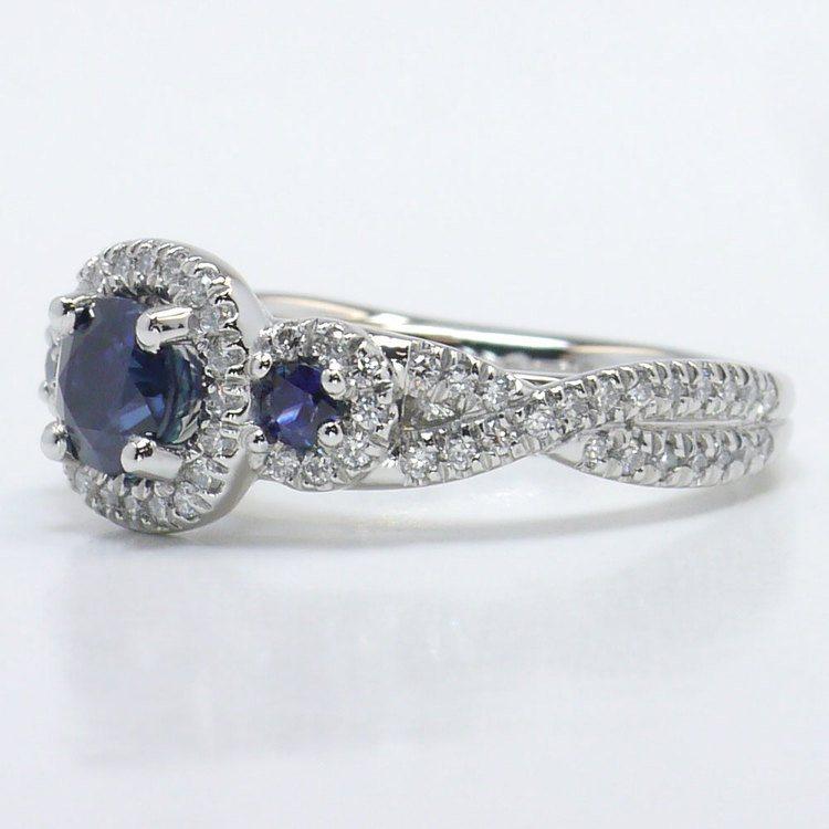 1 Carat Deep Blue Sapphire & Diamond Twisted Halo Engagement Ring angle 2