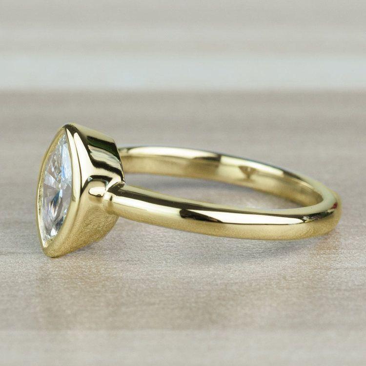 Elegant Marquise Solitaire Bezel Set Diamond Engagement Ring angle 2