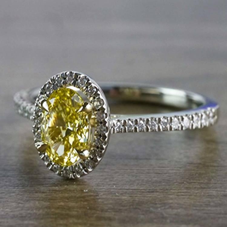 Intense Fancy Oval Yellow Diamond Ring In A Diamond Halo angle 2