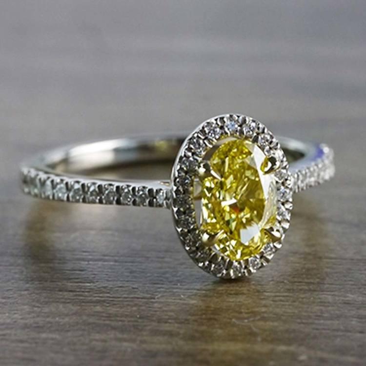 Intense Fancy Oval Yellow Diamond Ring In A Diamond Halo angle 3