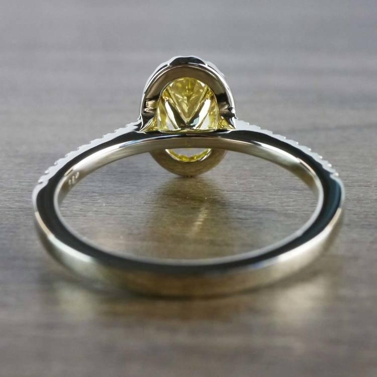 Intense Fancy Oval Yellow Diamond Ring In A Diamond Halo angle 4