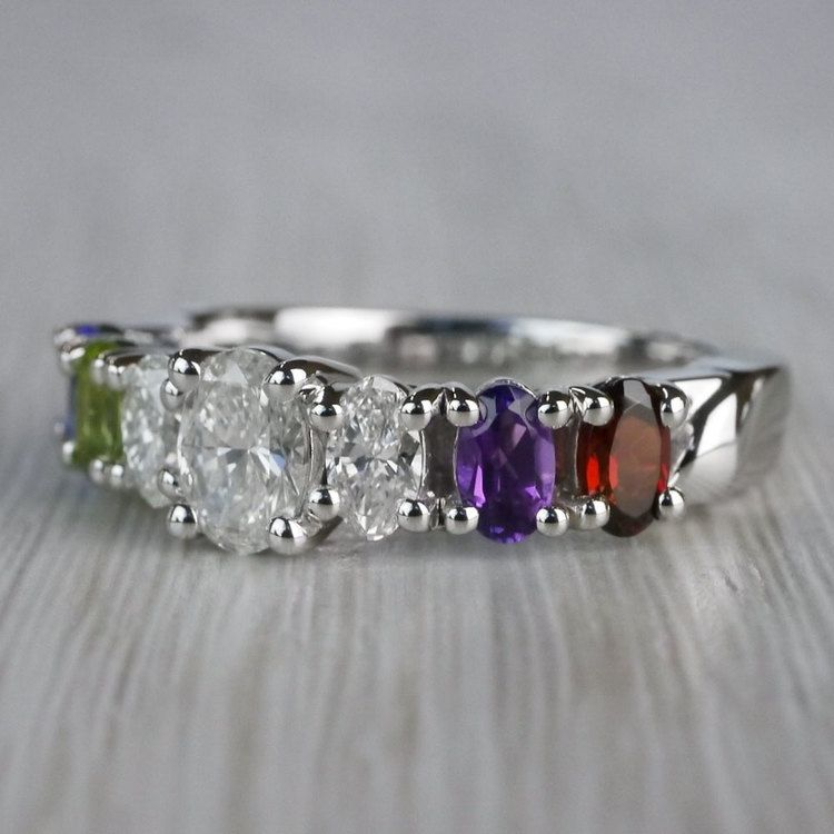 Magnificent Various Gemstones & Oval Diamond Engagement Ring angle 2