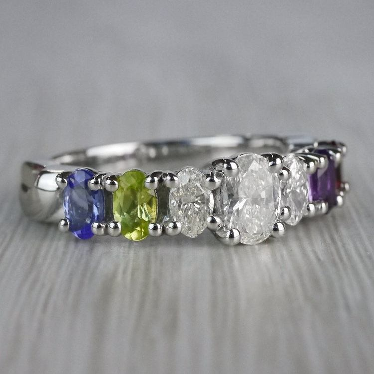 Magnificent Various Gemstones & Oval Diamond Engagement Ring angle 3