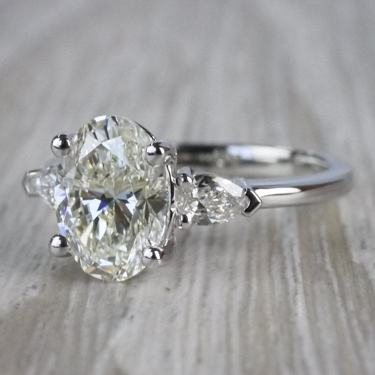 Outstanding Oval Diamond & Pear Cut Diamond Ring angle 2