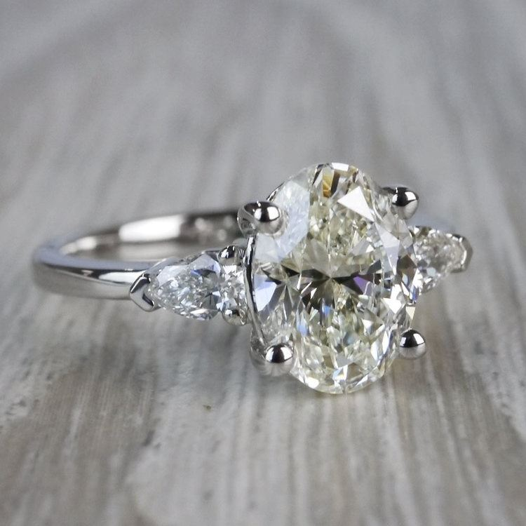 Outstanding Oval Diamond & Pear Cut Diamond Ring angle 3