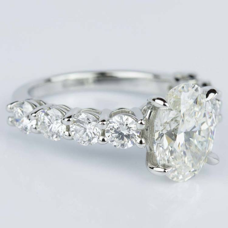 Oval Cut Engagement Ring with Large Side Diamonds in Platinum angle 3