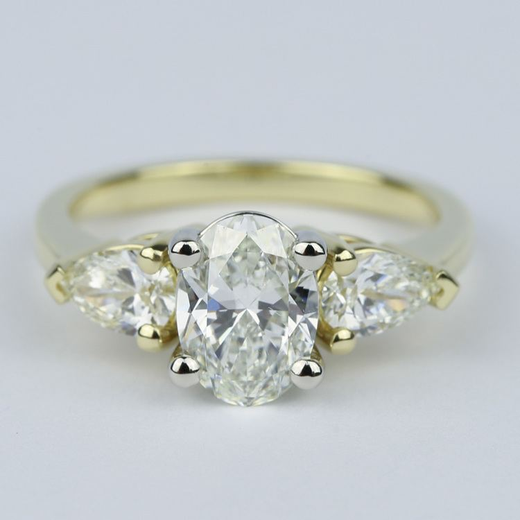 Oval Diamond Engagement Ring with Pear Side Diamonds