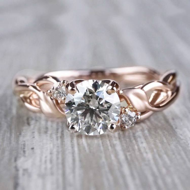 Floral Style Three Stone Engagement Ring In Rose Gold