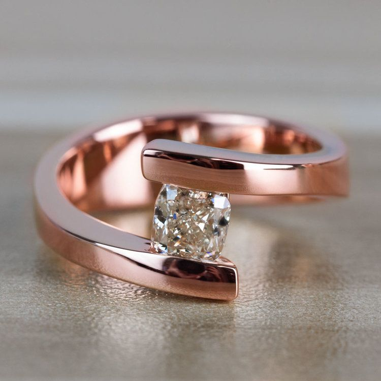 Sleek Bypass Engagement Ring with a Cushion Cut Diamond