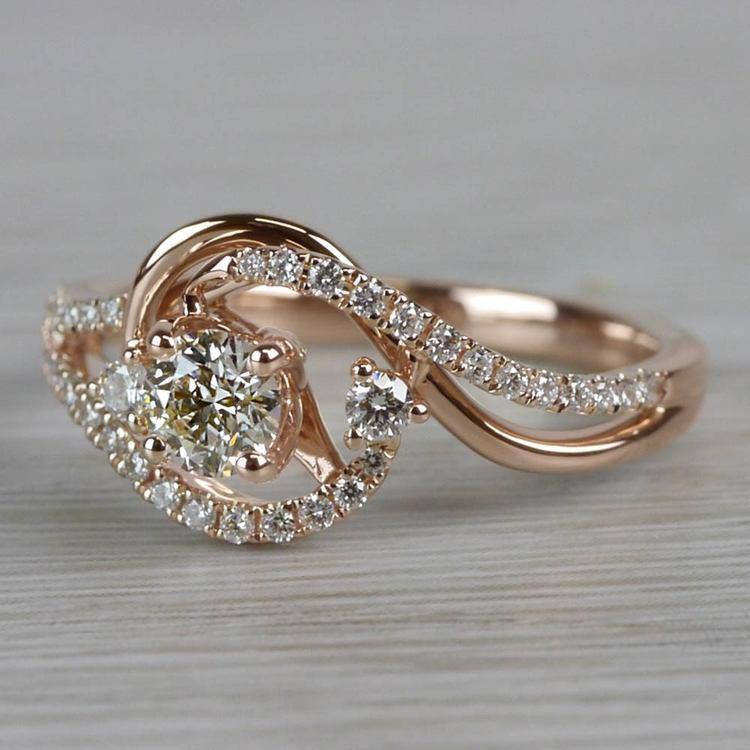 Sparkling Swirled Round Cut Diamond Rose Gold Engagement Ring angle 2