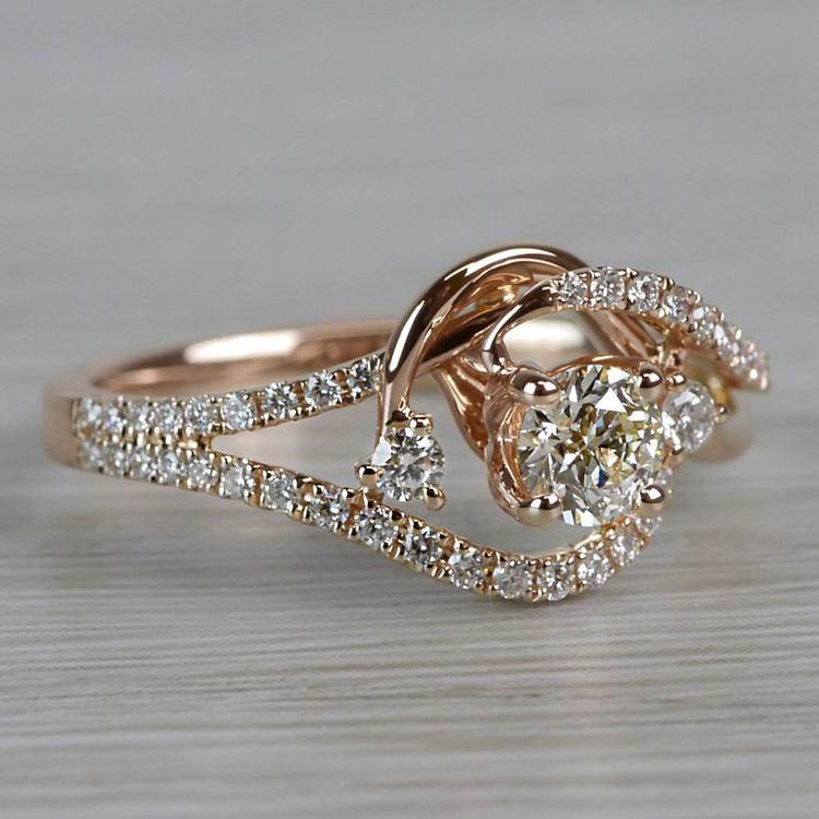 Sparkling Swirled Round Cut Diamond Rose Gold Engagement Ring angle 3