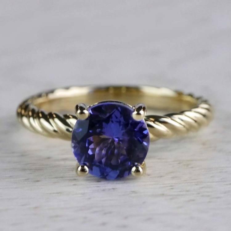 Stunning Blue Tanzanite Engagement Ring In Yellow Gold