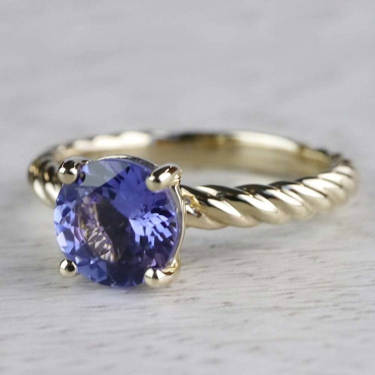 Stunning Blue Tanzanite Engagement Ring In Yellow Gold angle 2