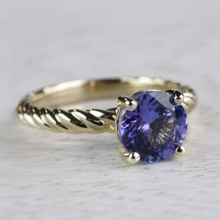 Stunning Blue Tanzanite Engagement Ring In Yellow Gold angle 3
