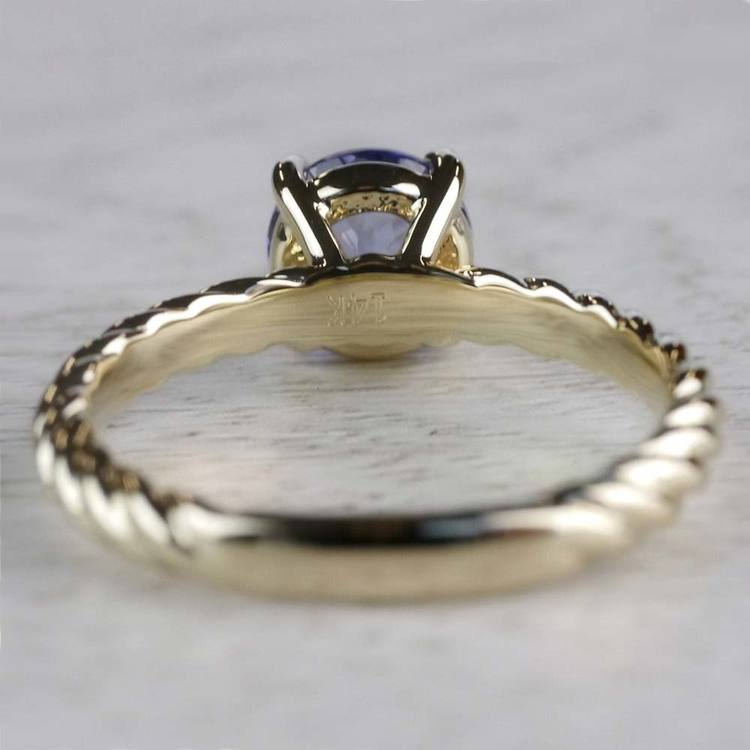 Stunning Blue Tanzanite Engagement Ring In Yellow Gold angle 4