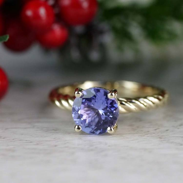 Stunning Blue Tanzanite Engagement Ring In Yellow Gold angle 5