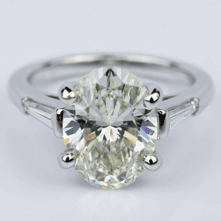 Three Stone Oval and Tapered Baguette Diamond Engagement Ring in Platinum (3.55 ct.)