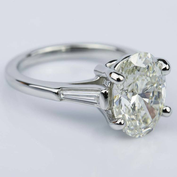 Three Stone Oval And Tapered Baguette Diamond Engagement