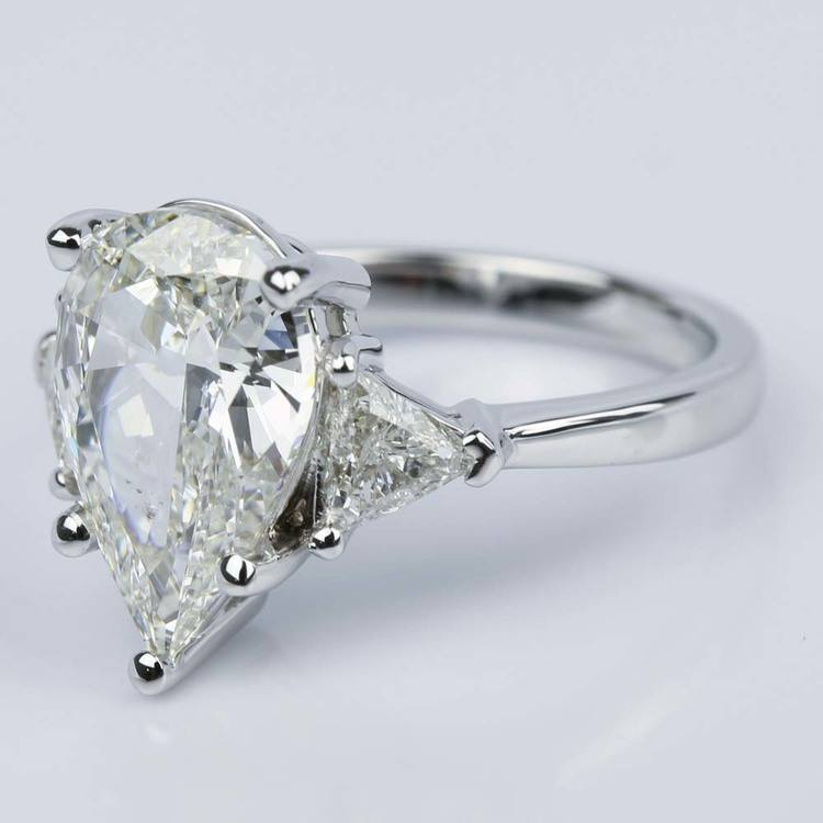 Three-Stone Trillion Engagement Ring with Pear Diamond Center angle 2
