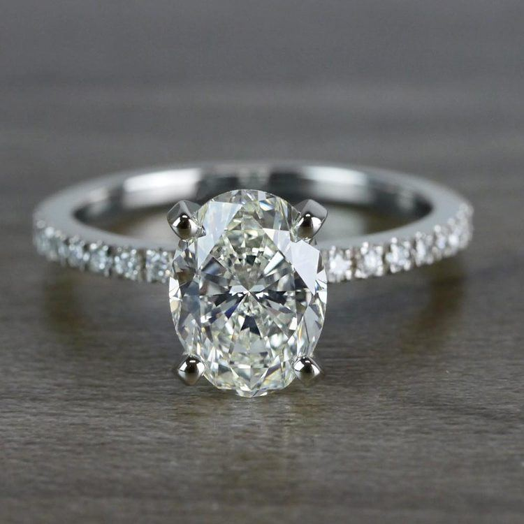 Whimsical White Gold Engagement Oval Diamond Ring
