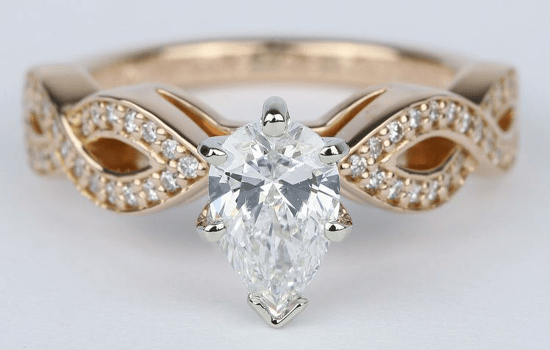 rose_gold_pave_pear_cut_diamond_ring.png