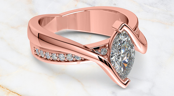 style guide rose gold engagement ring  with a marquise diamond
