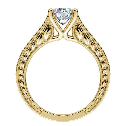 antique sapphire gemstone engagement ring in yellow gold
