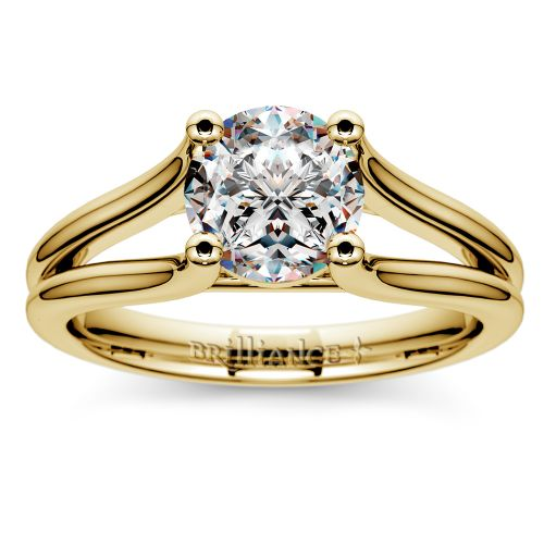 curved split shank solitaire engagement ring in yellow gold