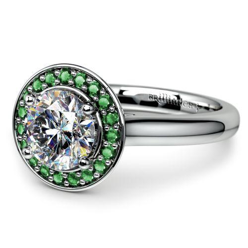 halo emerald gemstone engagement ring in platinum