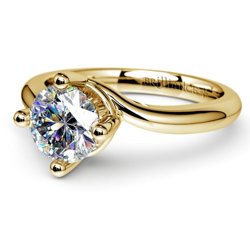 swirl style solitaire engagement ring in yellow gold